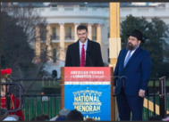 Adam J. Szubin, left, the Treasury's acting under secretary for terrorism and financial intelligence, finishes his remarks Sunday at the close to 4,000-strong 2016 National Chanukah Menorah Lighting ceremony on the Ellipse across from the White House as Rabbi Levi Shemtov, executive vice president of American Friends of Lubavitch (Chabad), prepares to take the podium. In his speech, Shemtov referred to the United Nations as a place of darkness and noted what Israel has recently faced there. Photo by Jeff Malet via Newscom.