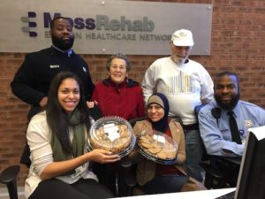 ▲ Sue and Hal Rosenthal (back row) helped deliver cookies to hospital staff on Christmas Day.