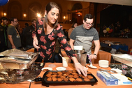 One of the participating restaurants getting ready to hand out plates of their latkes at the 14th annual Latkepalooza, held Dec. 18 at the Gershman Y. Mario Manzoni