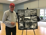 MIlton Dienes poses with a collection of photos he took and processed of scenes in Nagasaki and Hiroshima. Photo by Marissa Stern