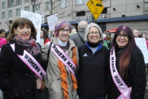 (Left to right) Dale Suib, Victoria Neely, Christine Markle and Dory Chasanoff wore pink sashes to show their solidarity. Photo by Rachel Kurland