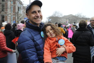 Rabbi Seth Goren, executive director of Repair the World Philadelphia, brought his 5-year-old daughter, Liana, to the march. Photo by Rachel Kurland