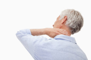Mature man having a neck pain