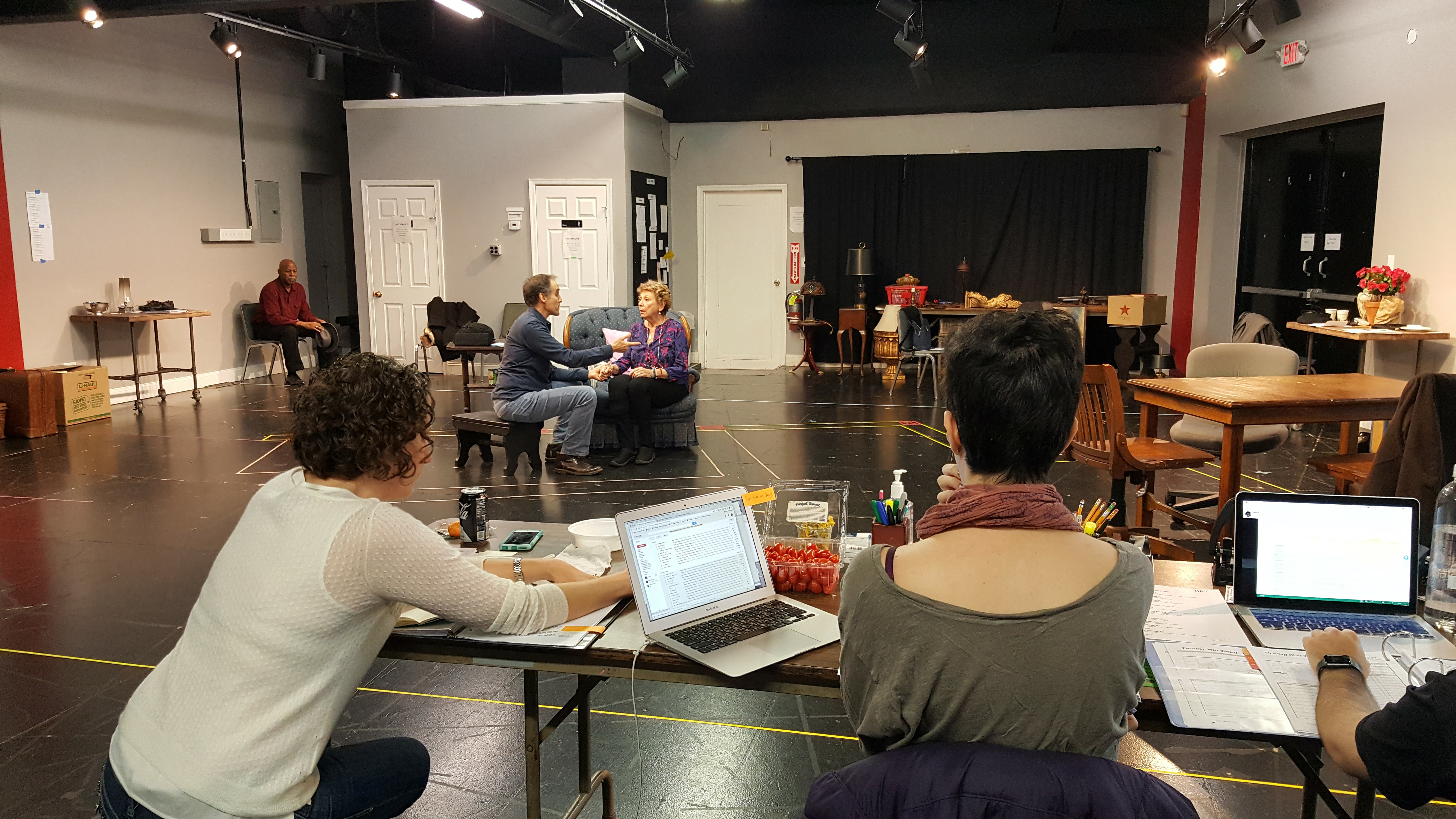 Marvin Bell as Hoke (far left); Michael Samuel Kaplan as Boolie and Lucy Martin as Daisy (center); director Amy Kaissar (front left) and stage manager Lauren Bieber (front right) at desk during rehearsal. Photo provided