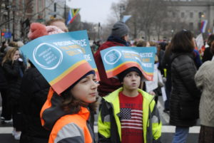 Young boys wore American Jewish World Service signs as hats. Photo by Rachel Kurland