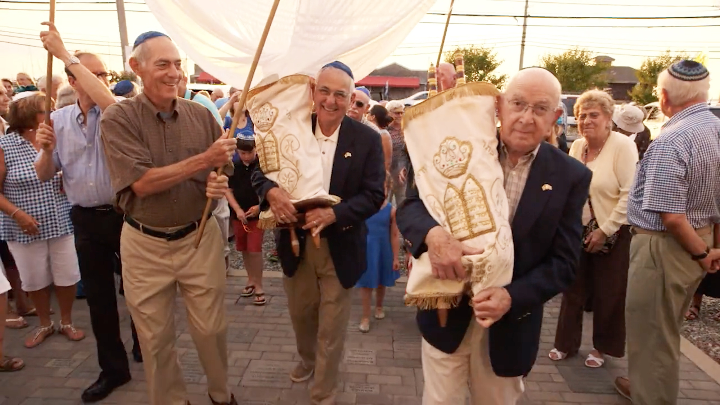 Mickey Radman, right, holds the Torah from his Latrobe, Pa., shul in a still from There Are Jews Here. Photo courtesy 371 Productions.