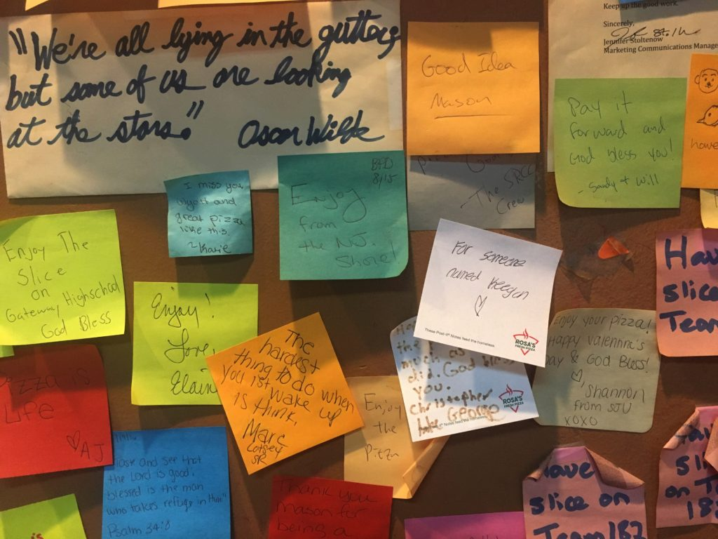 Post-it notes with messages on Rosa's walls. Photo by Marissa Stern
