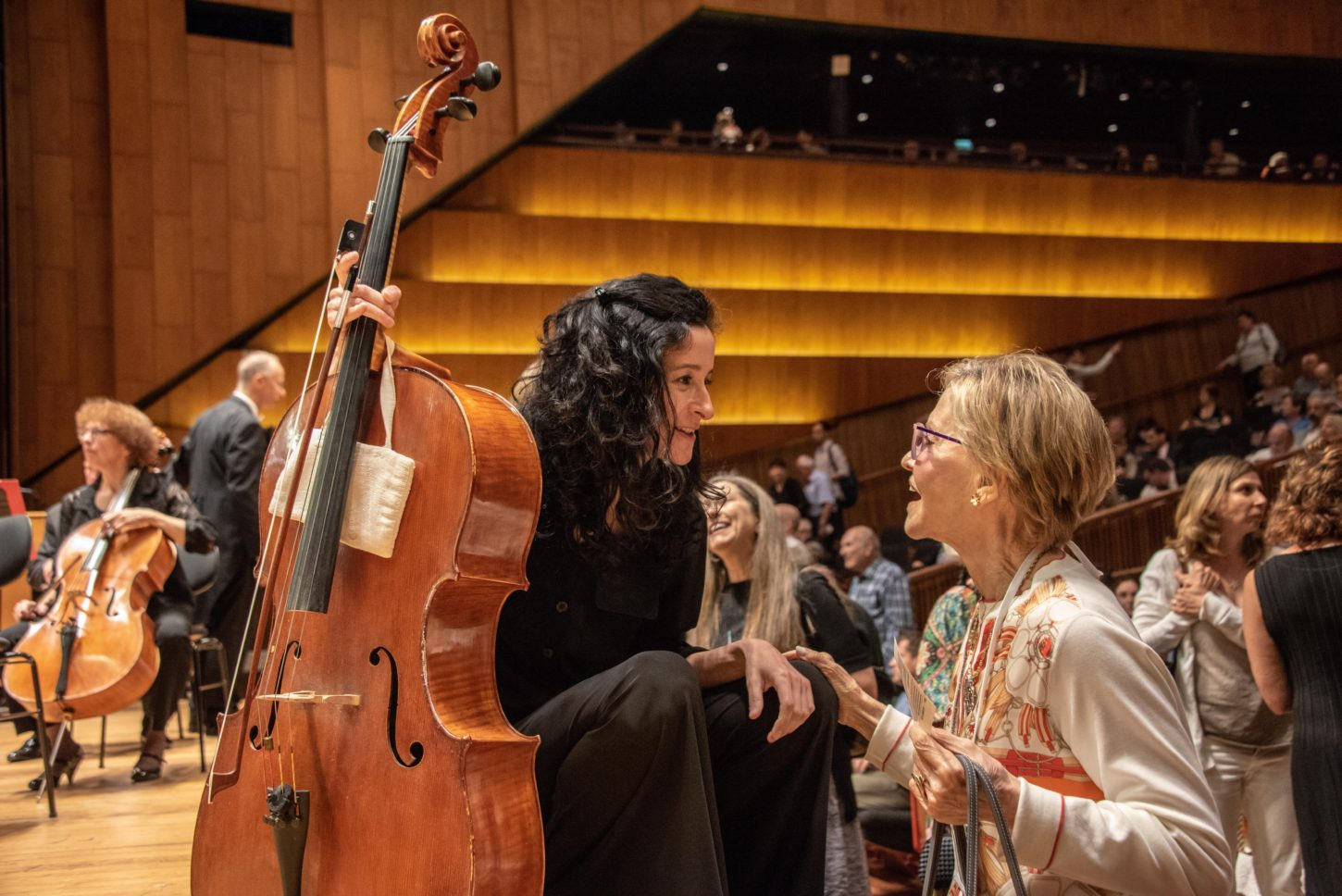 Connie Smukler chats with Philadelphia Orchestra cellist Yumi Kendall prior  to a performance at the Charles Bronfman Auditorium in Tel Aviv. f9d70f7f53f