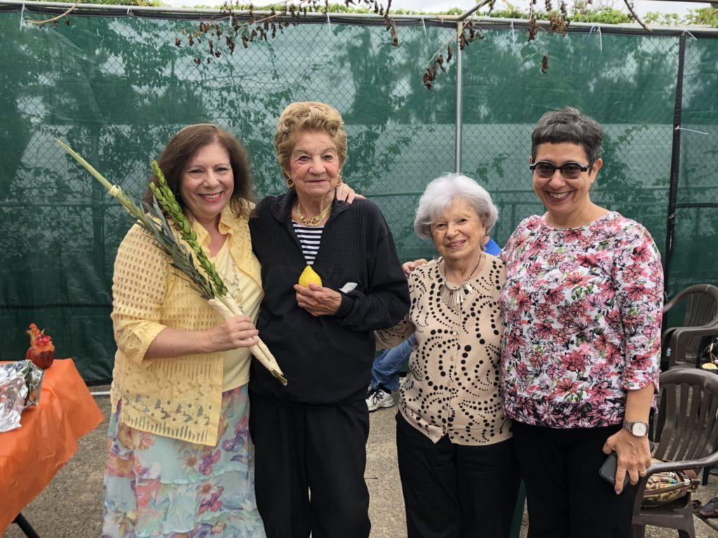 Rabbi Sandra Berliner, senior members Ruth Kligman and Belle Magerman, and Active Adult Life Director Sue Aistrop