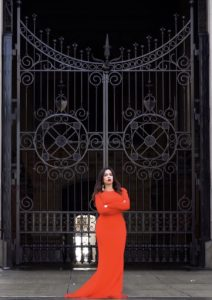 Irina Goldstein, a candidate for Philadelphia City Council, stands in front of a gate