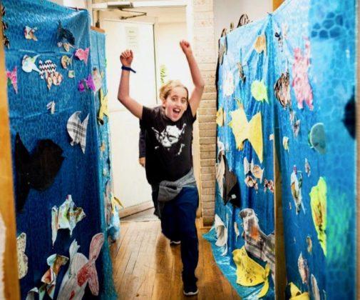 Maya Gavrin runs through a splitting of the red sea installation