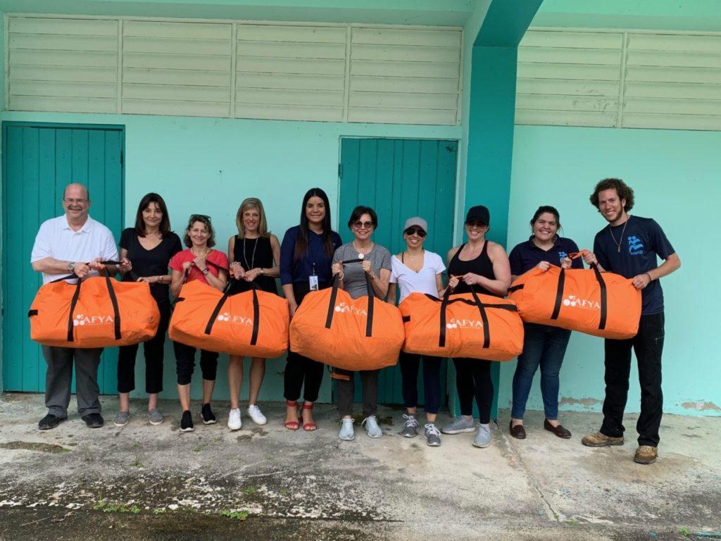 Participants with orange duffel bags