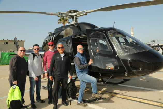 Bob Seltzer, Brad Bernstein, Jonathan Goldstein, Glenn Fischer and Glenn Blumenfeld board a helicopter to tour the Syrian and Lebanon borders.