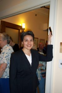 Senior Rabbi Jill Maderer with her hand on a mezuzah