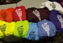 A pile of Maccabi t-shirts