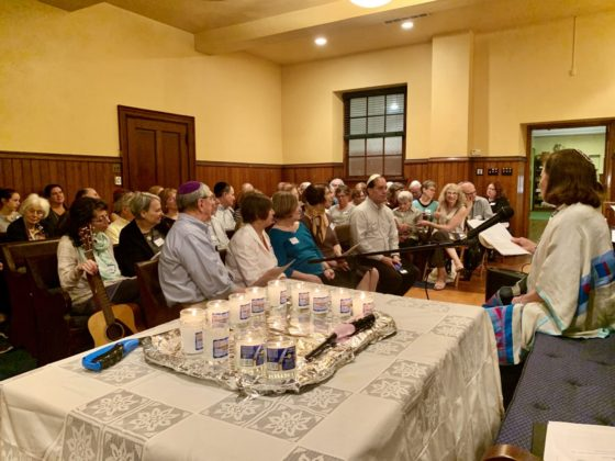 Or Zarua community members listen to Irma Prestfelder