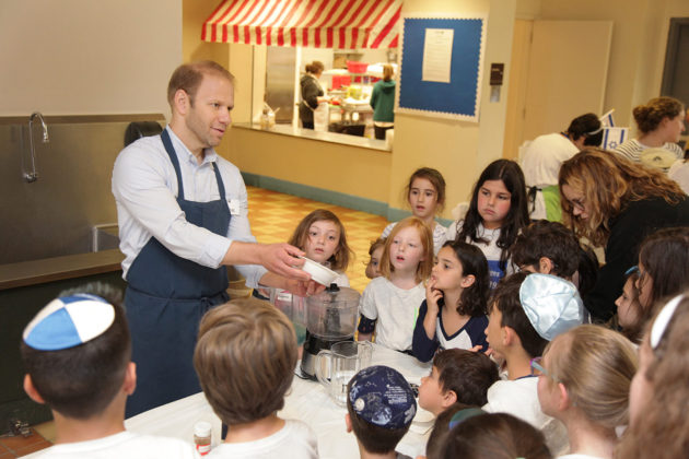 Steve Cook does a cooking demonstration for students