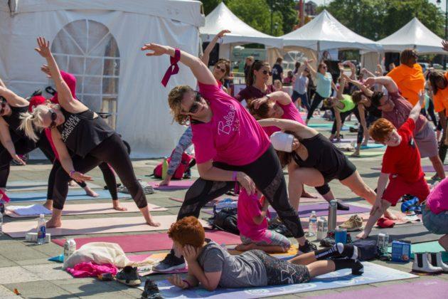 Carol Katz and Marisa Gefen, with Sam Gefen in front, do yoga