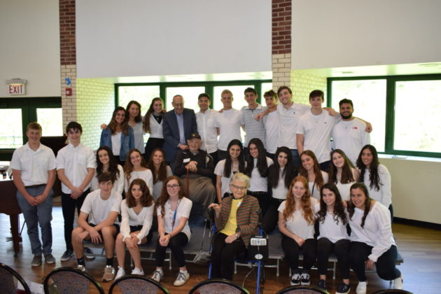 Holocaust Education And Reflection Club members pose with Wisnia.