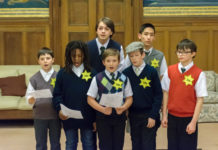 "A group of boys wearing yellow stars with 'Jude"" rehearse"