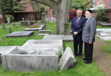Eli Gabay and Rabbi Albert Gabbai look at Mikveh Israel Cemetery