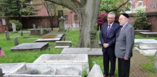 Eli Gabay and Rabbi Albert Gabbai look at Mikveh Israel Cemetery