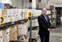 Jim Drucker in front of shelves