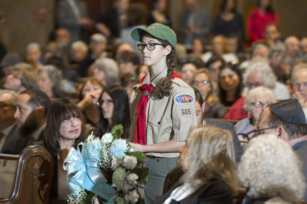 A Cradle of Liberty Scout presents a wreath