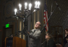 Howard Gershman lights a candle