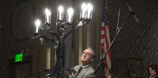Howard Gershman lights a candle