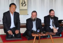 Nobuki Sugihara, Rabbi Yossy Goldman and Rabbi Yochonon Goldman sit for a tea ceremony at Shofuso Japanese House and Garden
