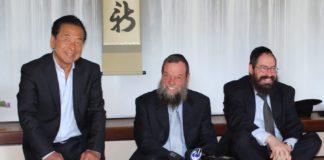 Nobuki Sugihara, Rabbi Yossy Goldman and Rabbi Yochonon Goldman sit for a tea ceremony at Shofuso Japanese House and Garden