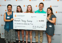 Corrie Gottsman of Ramah Day Camp is presented an award by first-year participants Maddie Gamburg, Kylie Cantos, Spencer Armon and Carina Hurok.