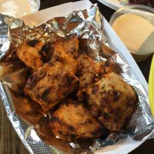 Cubes of grilled chicken in foil