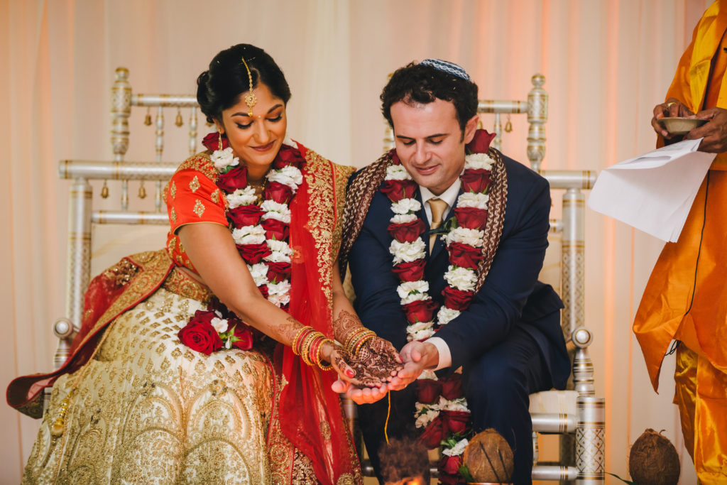 Jonathan and Ashwinnie Tahan sit at their Jewish-Hindu wedding