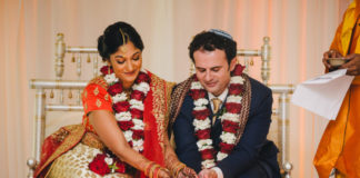 Jonathan and Ashwinnie Tahan sit at their Jewish-Hindu wedding
