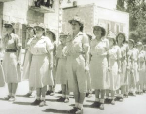 a black and white photo of Bella Lewensohn Schafer and otherwomen soldiers lining u