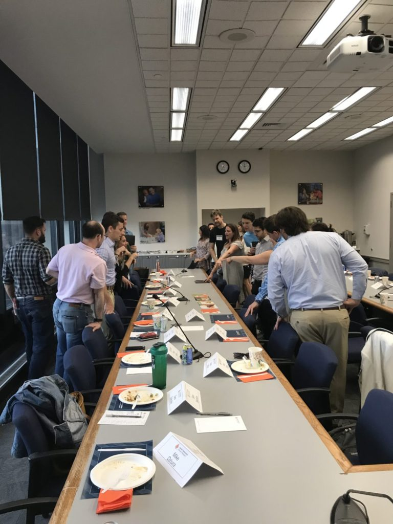 The 2019 Israel360 cohort  standing around a table