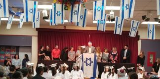 Rabbi Ira Budow speaks at the Abrams Hebrew Academy graduation ceremony.
