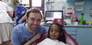 Avi Willis with a patient as part of the Dental Volunteers for Israel program