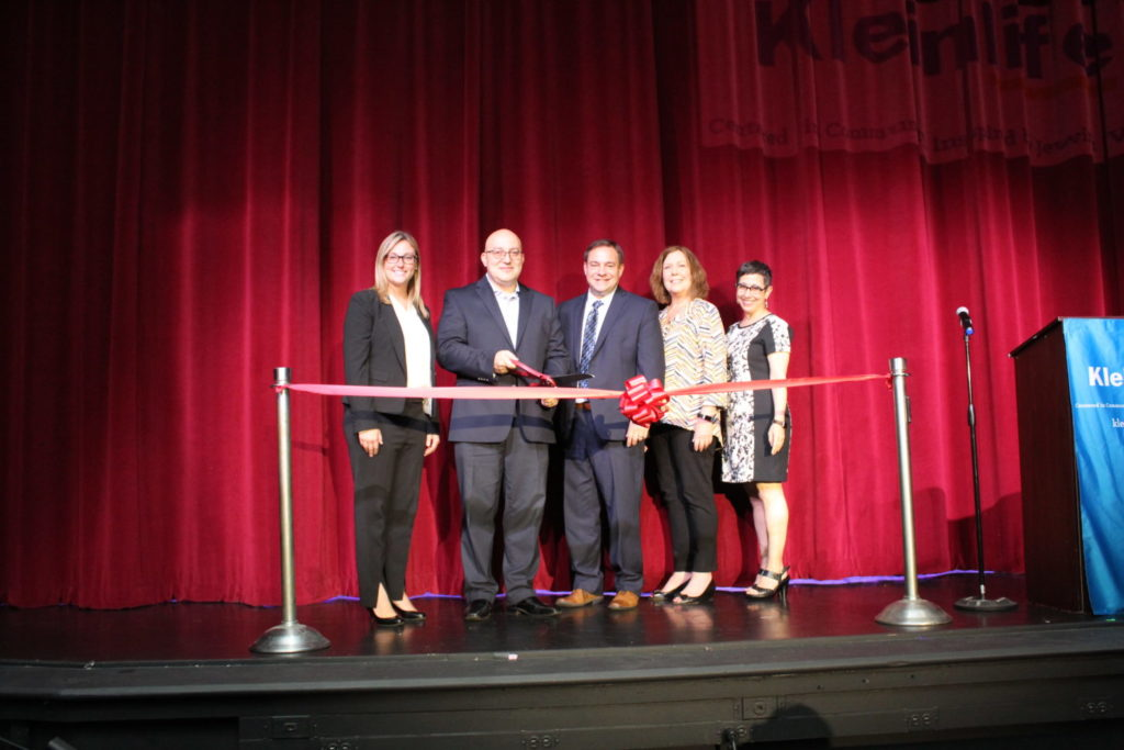 From left: State Rep. Martina White, Andrew Krug, state Sen. John Sabatina Jr., Holly Lange and Sue Aistrop cut the ribbon for the KleinLife theater