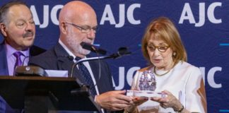 Co-chair Hon. Nelson Diaz observes while AJC board chair Morris Gocial presents the 2019 AJC Human Relations Award to Sally Cooper Bleznak.
