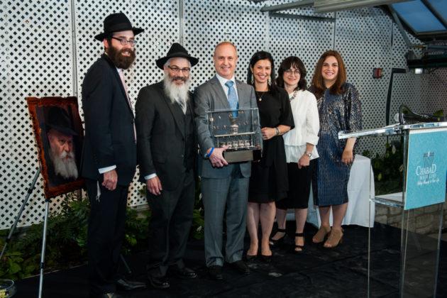 From left: Rabbi Mendy Cohen, Rabbi Shraga Sherman, Martin Wachs, Jenifer Wachs, Michal Sherman and Temma Cohen