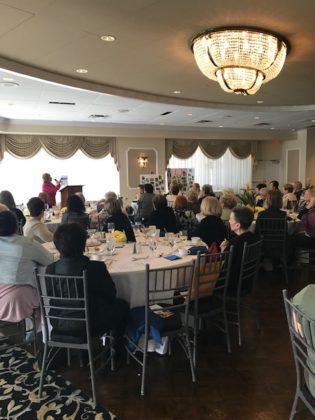 Hadassah women sit around tables