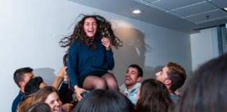 Mayah Dahan is lifted in a chair