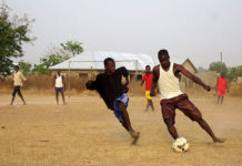 Children in Ghana play soccer