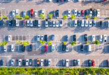 aerial view of a mostly filled parking lot