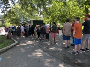 Hava NaGrilla attendees wait in line for kosher barbecue