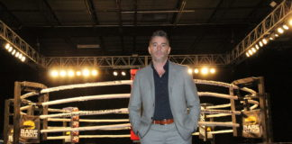 David Feldman, a bare knuckle fighting promoter, stands in front of ring