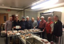 Temple Beth Hillel-Beth El Men's Club cook in a kitchen